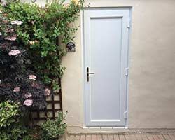 solid white upvc back door